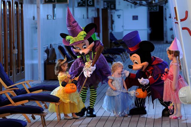 Mickey and Minnie with costumed children