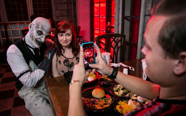 ScareActor Dining Experience Guests with actor at table